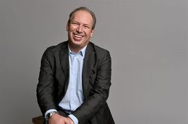 FILE - In this Feb. 2, 2015 file photo, Hans Zimmer poses for a portrait during the 87th Academy Awards nominees luncheon in Beverly Hills, Calif. Zimmer, who had a childhood fascination for Muhammad Ali, has supplied the music for the upcoming television series Premier Boxing Champions. The show's executive producer Michael Marto plans to broadcast 30-40 fights per year on a variety of networks, including NBC, CBS and Spike. The first fight premieres Saturday live on NBC. (Photo by John Shearer/Invision/AP, File)