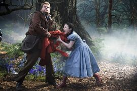 In this image released by Disney Enterprises, Inc., James Corden, left, and Lilla Crawford as Little Red Riding Hood appear in a scene from