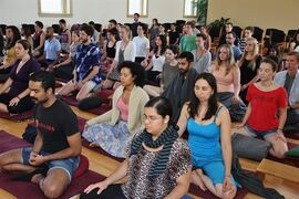 In this July 31, 2011 photo, a group meditates in the Insight Meditation Society (IMS) Retreat Center meditation hall in Barre, Mass. The Buddhist-influenced center offers silent retreats that allow individuals to take a break from the stresses and demands of daily modern life. The retreats are not entirely silent as there are lectures on Buddhist philosophy, meditation instruction and chanting along with set times for sitting, walking, yoga, working and eating. (AP Photo/ Insight Meditation Society)