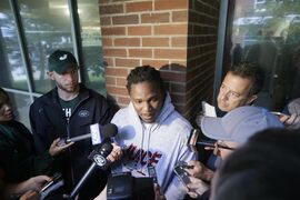 New York Jets running back Chris Johnson, center, responds to questions during a news interview before NFL football training camp on Wednesday, July 23, 2014, in Cortland, N.Y. (AP Photo/Frank Franklin II)
