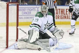 Dallas Stars goalie Anders Lindback (29), of Sweden, makes a save during the second period of an NHL hockey game against the New York Islanders, Saturday, Oct. 25, 2014, in Uniondale, N.Y. (AP Photo/John Minchillo)
