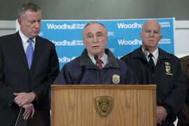 ADDS BOTH OFFICERS KILLED - New York Police Department Commissioner Bill Bratton speaks alongside Mayor Bill de Blasio, left, and NYPD's Chief of Department James O'Neill, right, during a news conference at Woodhull Medical Center, Saturday, Dec. 20, 2014, in New York. An armed man walked up to two New York Police Department officers sitting inside a patrol car and opened fire Saturday afternoon, killing both officers before running into a nearby subway station and committing suicide, police said. (AP Photo/John Minchillo)