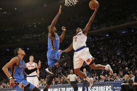 New York Knicks guard Langston Galloway (2) goes to the basket against Oklahoma City Thunder forward Serge Ibaka (9) during the second half of NBA basketball game, Wednesday, Jan. 28, 2015 at Madison Square Garden in New York. The Knicks won 100-92. (AP Photo/Mary Altaffer)