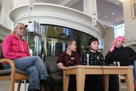 Nine-year-old Jason Rivera, center left, and Elijah Martinez, 11, center right, are joined by their mothers, Aulix Martinez, left, and Deirdre Kirk during a news conference, Friday, Nov. 28, 2014, at Westchester Medical Center's Maria Fareri Children's Hospital in Valhalla, N.Y. The boys spent seven hours trapped in the snow the night before until an alert police officer saw a shovel half buried and started to dig. (AP Photo/Times Herald-Record, Leonard Sparks)