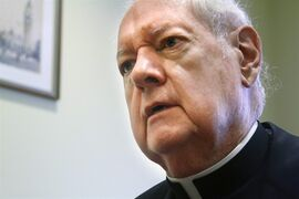 FILE- In this Aug. 19, 2011 file photo, Cardinal Edward Egan speaks with a reporter during an interview in New York. Egan, who was Archbishop-Emeritus, 12th bishop and 9th archbishop and 7th Cardinal of the See of New York, died of cardiac arrest, Thursday, March 5, 2015, in New York. He was 82. (AP Photo/Bebeto Matthews, File)