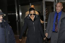 Singer Ashanti leaves the courthouse after testifying at Devar Hurd's trial in New York, Tuesday, Dec. 16, 2014. Ashanti said in testimony that she was