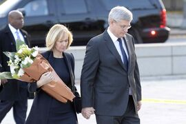 Prime Minister Stephen Harper and wife Laureen visit the Tomb of the Unknown soldier in Ottawa on Thursday. A gunman turned the nation's capital into an armed camp Wednesday after he fatally shot an honour guard at