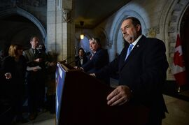 Government House Leader Peter Van Loan, left, and Minister of Infrastructure Denis Lebel take questions from media on Parliament Hill in Ottawa on Monday, January 26, 2015. THE CANADIAN PRESS/Sean Kilpatrick
