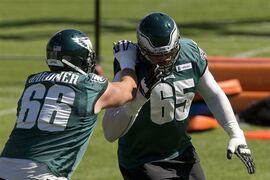 Philadelphia Eagles offensive tackle Lane Johnson (65) and tackle Andrew Gardner (66) run a drill during NFL football practice at the team's training facility, Tuesday, Sept. 30, 2014, in Philadelphia. (AP Photo/Matt Rourke)