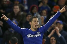 Chelsea's Eden Hazard celebrates scoring his team's sixth goal during the Group G Champions League match between Chelsea and Maribor at Stamford Bridge stadium in London, Britain, Tuesday, Oct. 21, 2014. (AP Photo/Alastair Grant)