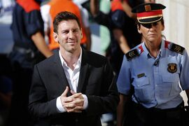 FILE - In this Sept. 27, 2013 file photo, FC Barcelona star Lionel Messi, left, arrives at a court to answer questions in a tax fraud case in Gava, near Barcelona, Spain. A Spanish judge on Monday July 28, 2014 has rejected a prosecutor's request to drop charges of tax fraud against Messi and ordered the investigation into three cases of suspected unpaid taxes to proceed. A court statement says there is