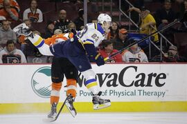 St. Louis Blues' Dmitrij Jaskin (23), of Russia, collides with Philadelphia Flyers' Sean Couturier (14) during the second period of an NHL hockey game, Thursday, March 5, 2015, in Philadelphia. (AP Photo/Matt Slocum)