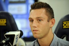 In this photo released by Lazio press office, Dutch defender Stefan de Vrij looks on during the official presentation in Rome, Thursday, July 31, 2014. (AP Photo, Marco Rosi, Lazio press office)