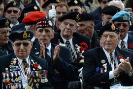 Canadian Second World War veteran Frank Graham, 92, centre, gives a thumbs up as veterans pay tribute to Canada's war dead at the Holten Canadian War Cemetery, near Arnhem, Netherlands, on Monday, May 4, 2015. THE CANADIAN PRESS/Sean Kilpatrick