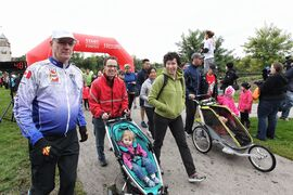 Scout, 1, and her parents Kerry Ryan (right), and Jeope Wolfe (left), take part in the Terry Fox Run Sunday.