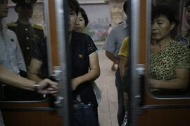 In this Sept. 1, 2014 photo, North Koreans enter a subway car at an underground subway station, in Pyongyang, North Korea. Time and again, Americans over the years have slipped into poor, deeply suspicious, fervently anti-American North Korea, crossing a border that tens of thousands of desperate North Koreans have crossed in the opposite direction, at great risk. Whatever their reasons, Americans detained in North Korea, including the three currently there, are major complications for Washington, which must decide between letting a U.S. citizen languish and providing Pyongyang with a huge propaganda victory by sending a senior U.S. envoy to negotiate a release. (AP Photo/Wong Maye-E, File)