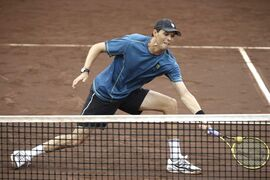Bob Bryan goes to the net as he and Mike Bryan play in the doubles final against Spain's David Marrero and Fernando Verdasco at the U.S. Men's Clay Court Championship tennis tournament Saturday, April 12, 2014, in Houston. (AP Photo/Pat Sullivan)