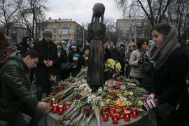 People light candles during a ceremony to commemorate victims of the 1932-33 Great Famine, or Holodomor,  in Kyiv, Ukraine, Saturday. Church bells tolled, candles flickered and national flags, adorned with black ribbons, flew as the country marked the anniversary of the start of a Soviet-era famine that killed millions.