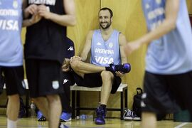 Spurs guard Manu Ginobili smiles as he sits on a bench during an Argentina national basketball team practice, in Buenos Aires, Argentina, Wednesday, July 30, 2014. Ginobili has expressed his intent to play for Argentina at the FIBA World Cup despite a stress fracture of the lower fibula of his right leg. It's unclear when Ginobili was injured. (AP Photo/Victor R. Caivano)