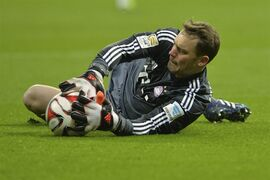 Bayern's goalkeeper Manuel Neuer saves a ball during the soccer match between FC Bayern Munich and 1. FC Cologne in the Allianz Arena in Munich, Germany, on Friday, Feb. 27, 2015. (AP Photo/Kerstin Joensson)