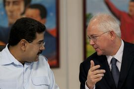 FILE - In this Nov. 15, 2013, file photo, Venezuela's President Nicolas Maduro, left, speaks with his Oil Minister Rafael Ramirez before the start of a press conference at Miraflores presidential palace in Caracas, Venezuela. President Maduro has replaced on Tuesday Sept. 2, 2014, Venezuela's longtime oil minister and economic czar as part of a cabinet shakeup sidelining the most-prominent voice within his administration for much-needed reforms to address the country's economic crisis. (AP Photo/Ariana Cubillos, File)