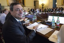 President of European Central Bank Mario Draghi sits at the table prior to the start of the ECB governing council meeting in Naples, Italy, Thursday, Oct. 2, 2014. European Central Bank head Mario Draghi is expected Thursday to underline the bank's willingness to deploy more economic stimulus measures, a stance that could send the euro skidding even lower. And a drop in the currency — which helps eurozone exporters and could nudge up worryingly low inflation — might be the most effective stimulus to come out of the ECB's monthly meeting. (AP Photo/Lapresse, POOL)
