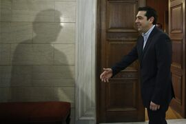 The shadow of Eurogroup chairman Jeroen Dijsselbloem is cast on a wall as Greek Prime Minister Alexis Tsipras waits to greets him during their meeting in Athens, Friday, Jan. 30, 2015. Dijsselbloem is in Athens for talks with Greece's new left wing government after it promised to renege on key bailout commitments required for repayment of a 240 billion euro ($270 billion) rescue package. (AP Photo/Petros Giannakouris, Pool)