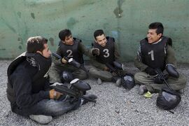 In this Friday, Aug. 22, 2014 photo, men have a chat after playing a paintball game in Kabul, Afghanistan. The arrival of recreational paintball to Afghanistan may seem peculiar to outsiders, especially in a country that's known decades of war, faces constant bombings and attacks by Taliban insurgents and is preparing its own security forces for the withdrawal of most foreign troops by the end of the year. However, it shows both the rise of a nascent upper and middle class looking for a diversion with the time to spare, as well as the way American culture has seeped into the country since the 2001 U.S.-led invasion to topple the Taliban. (AP Photo/Rahmat Gul)