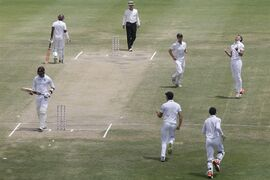 England's James Anderson, top right, celebrates taking the wicket of West Indies' Marlon Samuels, bottom left, during the last day of their first cricket Test match at the Sir Vivian Richards Cricket Ground in Antigua, Antigua and Barbuda, Friday, April 17, 2015. (AP Photo/Ricardo Mazalan)