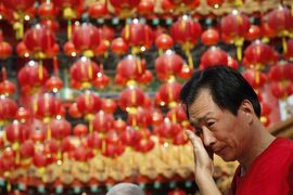 A Chinese family member of a passenger on board the missing Malaysia Airlines Flight 370, cries after praying at a temple in Kuala Lumpur, Malaysia, Sunday, March 1, 2015. Australia, Indonesia and Malaysia will lead a trial to enhance the tracking of aircraft over remote oceans, allowing planes to be more easily found should they vanish like Malaysia Airlines Flight 370, Australia's transport minister said Sunday. The announcement comes one week ahead of the anniversary of the disappearance of Flight 370, which vanished last year on a flight from Kuala Lumpur to Beijing with 239 people on board. No trace of the plane has been found. (AP Photo/Vincent Thian)