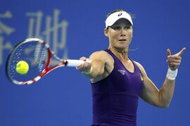 Samantha Stosur of Australia returns a shots to Caroline Wozniacki of Denmark during the China Open tennis tournament at the National Tennis Stadium in Beijing, China, Wednesday, Oct. 1, 2014. (AP Photo/Vincent Thian)