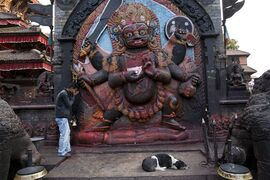 A man offers prayers to Hindu God Bhairav at Basantapur Durbar Square, a lot of which was damaged in Saturday's earthquake, in Kathmandu, Nepal, Sunday, April 26, 2015. The earthquake centered outside Kathmandu, the capital, was the worst to hit the South Asian nation in over 80 years. It destroyed swaths of the oldest neighborhoods of Kathmandu, and was strong enough to be felt all across parts of India, Bangladesh, China's region of Tibet and Pakistan.(AP Photo/Bernat Armangue)