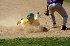 St. James A's player Dawson McKenzie gets dirty stealing third base.