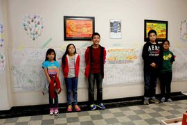 Left to right: Sargent Park School students Joanna Monte, Zhan Santos, Aaron Herrera, Aaron Dimacali, and Rachille Abaga are pictured standing by the diversity and equity wall, a collaborative project by students of all grade levels which depicts what the idea of human rights means to each of them.