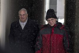 Former university professor Benjamin Levin (right), who faces child pornography charges, arrives at court in Toronto, Tuesday, March 3, 2015 with his lawyer Clayton Ruby. THE CANADIAN PRESS/Chris Young