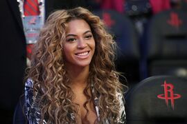 Beyonce sits courtside before the NBA All-Star basketball game in Houston, Sunday, Feb.17, 2013. Beyonce is one of the satrs who lend their voices to the new animated film,