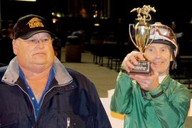 Balooga Bull's trainer Ardell Sayler, left, and jockey Paul Nolan with their unprecedented third consecutive Gold Cup.