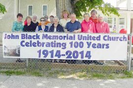 Erna Braun, MLA for Rossmere, joins the John Black Memorial United Church's anniversary organizing committee for their 100th Anniversary Block Party on Sat., June 7, 2014.