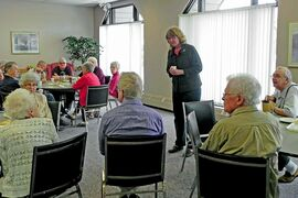 Erna Braun, MLA for Rossmere, visits with seniors at the Donwood South apartments during a coffee party.
