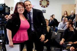 Point Douglas MLA Kevin Chief announces $900,000 in funding over three years for the Momentum Centre through the Manitoba Works! program. Chief is pictured with Alicia Pifer, a successful former program participant from the centre.
