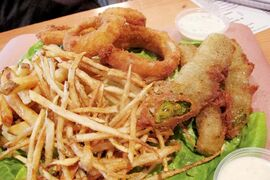 Sides at Market Burger include delicious deep-fried pickles and shoestring fries.