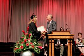 Madelin Pineau receiving her award at Kelvin High School graduation. Some of Madelin's selfless examples of citizenship include collaborating with two other students to begin a Brick by Brick campaign (through Me to We) raising $1,000 to build a school in Kenya, volunteering for nearly a decade at the Japanese Pavilion for Folklorama and helping to raise $800 to aid those affected by the tsunami.