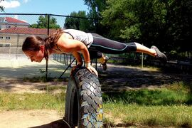 Health and fitness columnist Tania Tetrault Vrga balances on a tire in a playground in Bulgaria. Many Eastern Europeans are able to sculpt great physiques using only the equipment found at adult playgrounds.
