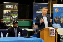 Afro-Caribbean Association past-president Jim Ogunnoiki (seated) and Jim Maloway bringing greetings from the province at last year's Afro-Caribbean Association Job Fair. This year's fair will be held at Elmwood High School on Feb. 21.