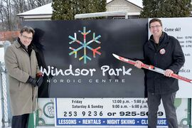 St. Vital Coun. Brian Mayes, left, and St. Boniface Coun. Matt Allard stand in front of the Windsor Park Nordic Centre.