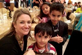 Erin Selby, MLA for Southdale, joins Simi Mehta's sons Chirag and Mehar at Mehta's crowning of People's Choice Mrs. South Asia Canada.