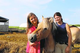 Louise May (left) and her daughter Zona at Aurora Farms with Abby, the horse.