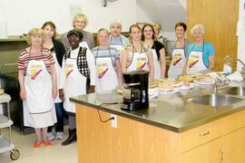 Volunteers cook together at North Kildonan Mennonite Church's Community Kitchen program.