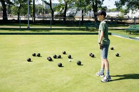 Jacob Braun gives lawn bowling a try in St. John's Park.