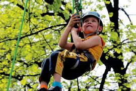 Four-year-old Jacob Genaille has a look around after being hoisted high up in the air during Arbor Day dleebrations in May at Kildonan Park — just one way people can interact with nature and wildlife in the park.